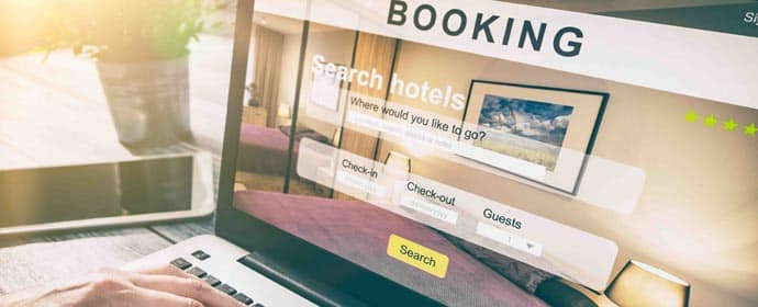 Laptop displaying Hotel Booking
