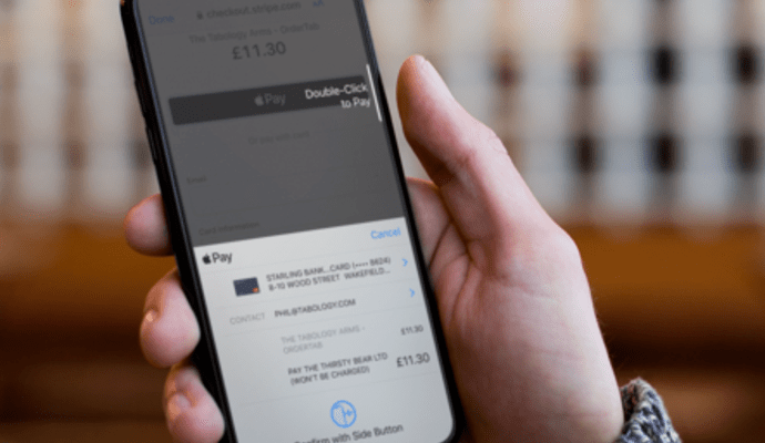 Man using Apple Pay on a drinks ordering app